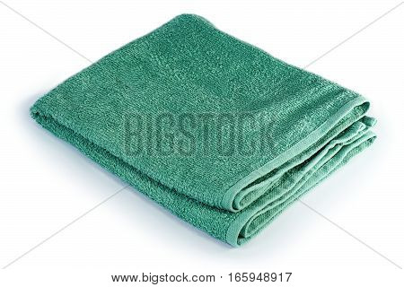 green folded towel isolated over white background
