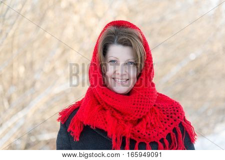 Russian woman with a red knitted shawl outdoors