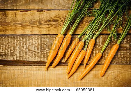 fresh and crunchy carrots on a wooden table