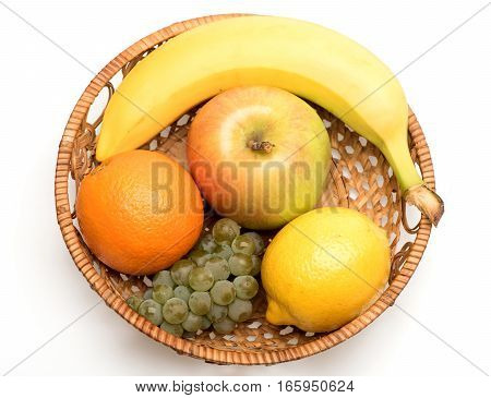 Banana, Lemon, Apple, Grapes And Orange Fruit In Straw Basket