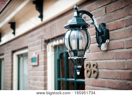 Street lamp hanging on a brick wall