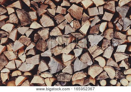 Chopped and stacked birch firewood as a background