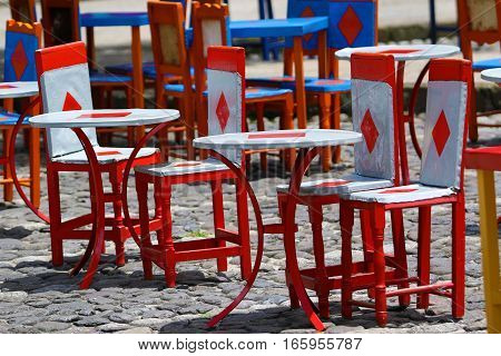 colourful cow hide chairs outdoors on coffee-shop patio in El Jardin Colombia