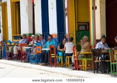 September 30 2016 El Jardin Colombia: locals relaxing in the shade in a coffee shop in the center of the tourist town