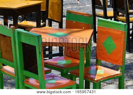 colurful painted cow hide chairs in the center of El Jardin Colombia of the local coffee shops