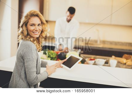 Young Couple In The Modern Kitchen
