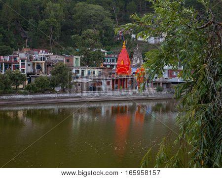 REWALSAR, INDIA. 2 June 2009: The temples reflected in the lake Revalsar. District Mandi, Himachal Pradesh, district of Kangra, India.