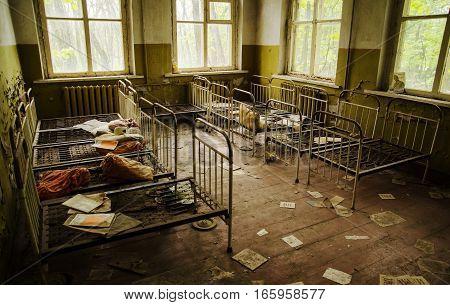 Chernobyl, Ukraine - April 24, 2015: Old Rusty Soviet Beds In Kindergarten At Chernobyl Ghost Town,