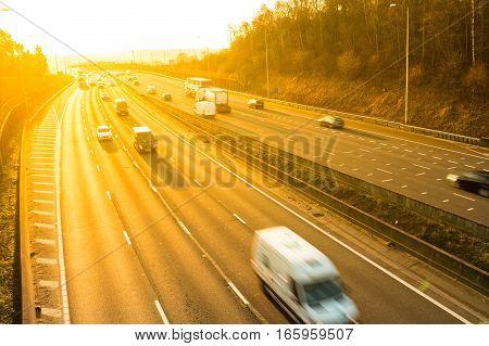 Road transport - Orange sunset above motorway