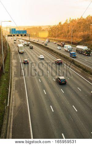 LONDON UK - JANUARY 18 2017: Sunset above busiest British motorway M25