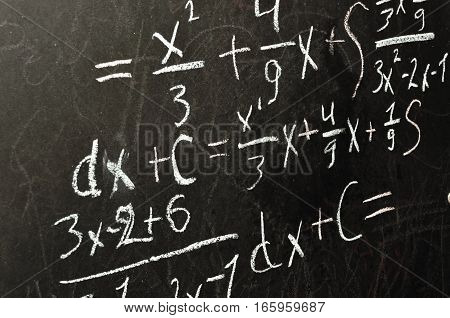 math solution on the blackboard, equation, and tasks