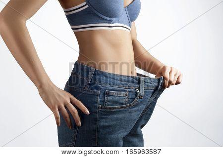 Successful weight loss beautiful female waist diet concept