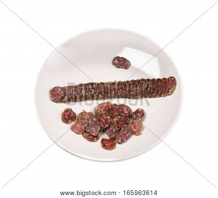 Plate with sausage sliced Fouette isolate on a white background