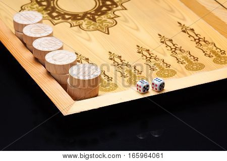 The game backgammon on the wooden table