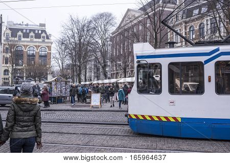 Amsterdamthe Netherlands-December 302016:On the street walking people and moving vehicles