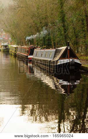FRONCYSYLLTE WALES UK - JANUARY 17 2017: Barges moored up for the winter on the Llangollen branch of the Shropshire Union canal a popular alternative lifestyle and vacation activity