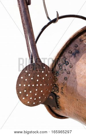 isolated old pots and ladle hanging in the kitchen