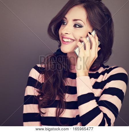 Beautiful Makeup Happy Woman Talking On Mobile Phone On Grey Background With Toothy Smiling Looking