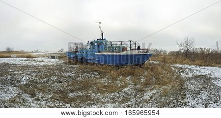 Rostov - on - Don, Russia - January 20, 2017: Old rusty ship on ashore in winter time.