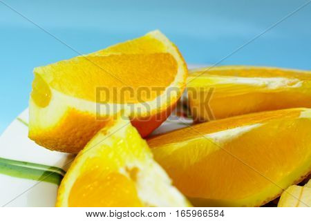 slices of orange on a blue background