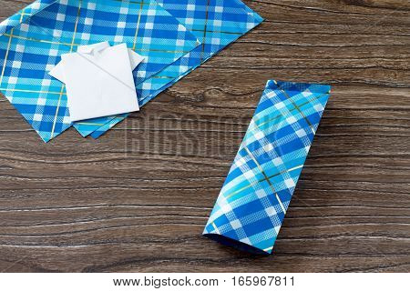 Gift For Father's Day. The Child Makes A Gift Of Origami Paper Shirt. Sheets Of Paper And A Shirt On
