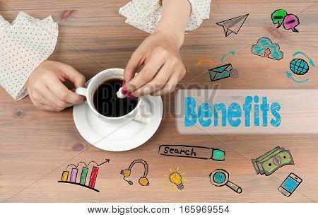 Benefits. Coffee cup top view on wooden table background.