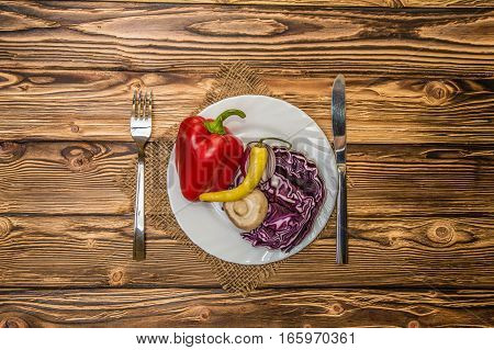 on a wooden table vegetables on the plate