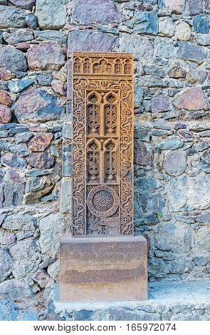 The old khachkar with fine patterns at the wall of Geghard Monastery Kotayk Province Armenia.