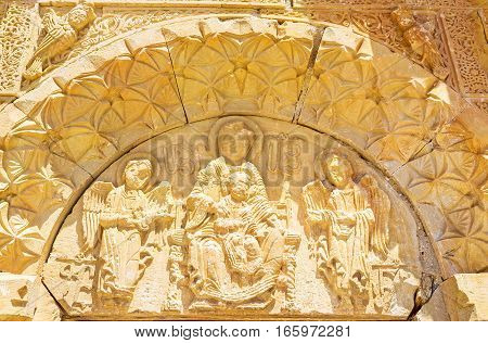 The relief icon of tympanium of Surb Astvatsatsin Church depicts the Virgin Mary with Jesus Archangels Gabriel and Michael on the sides surrounded by complex reliefs Noravank Monastery Vayots Dzor Armenia.