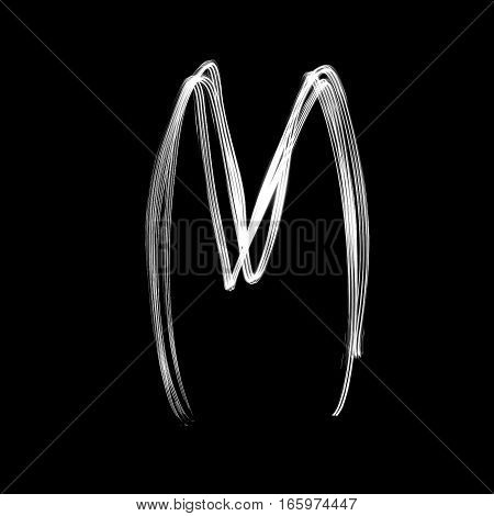 The letter M - written with light at night