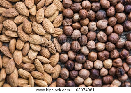 background completely filled with a mixture of nuts, hazelnuts and almonds