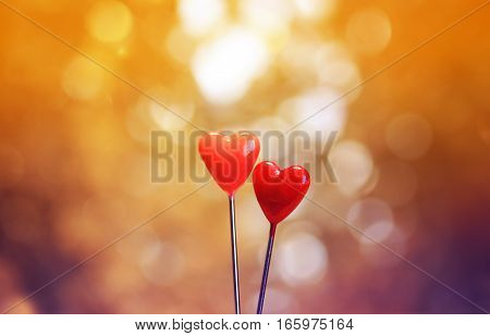 Two red hearts of lovers on a bright background greeting cards for Valentine's day