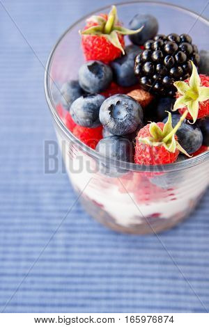 Yogurt With Granola And Berries On Wooden Background