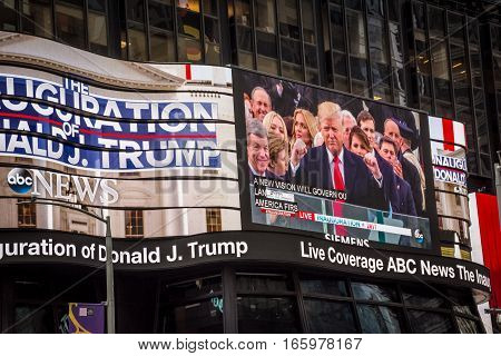 NEW YORK-JANUARY 20-People watch the Donald J.Trump inauguration as the 45th President of the United States in Times Square on January 20 2017 in New York City.
