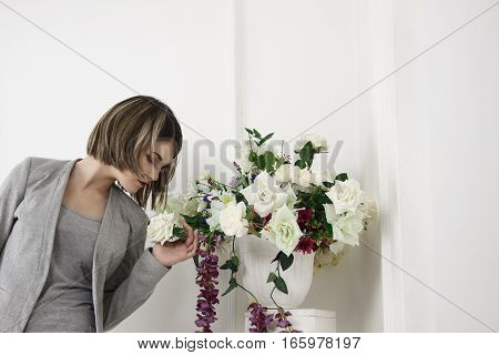 portrait of perfect beautiful girl in a suit.woman with flowers