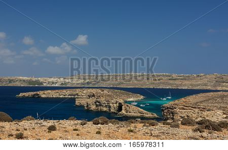 Panoramic view of Comino island, Malta. Emerald sea on sunny nice summery in popular holidays place Comuna island in Malta