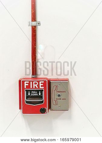 The fire switch and the emergency phone.