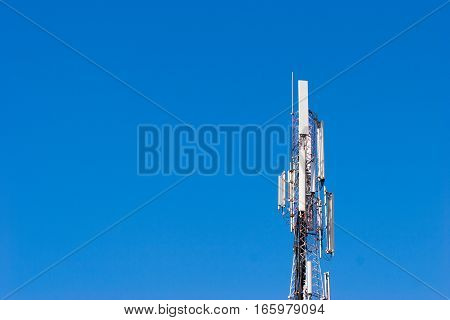 Cell tower shot against a blue sky