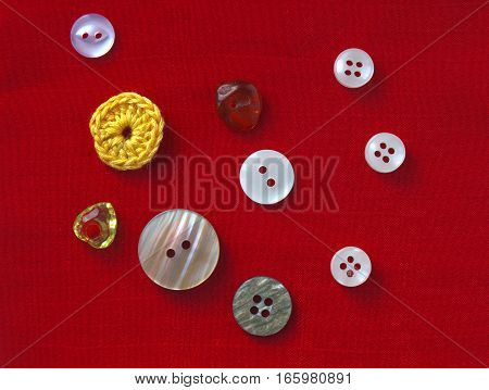 Red bright background with clothing Buttons and crochet elements