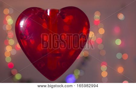 Red transparent heart on color background. No people
