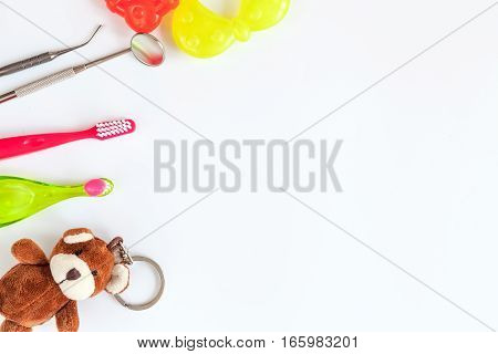 prevention and care for children's teeth on white background top view.