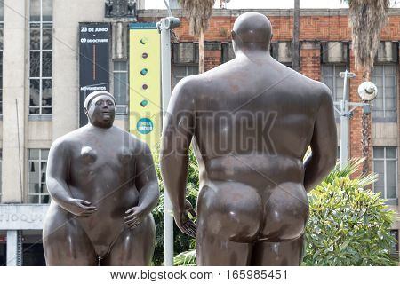 October 16, 2016 Medellin, Colombia: closeup details of Botero's surrealist statues of a man and a woman displayed in the plaza named after the author in the city center. The author is famous for creating overweight people statues.
