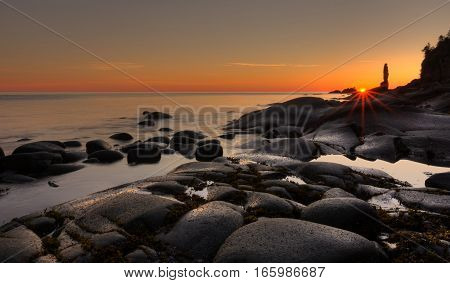 sunrise on the monolithe on the St-Laurence river in Gaspesie, Quebec, canada
