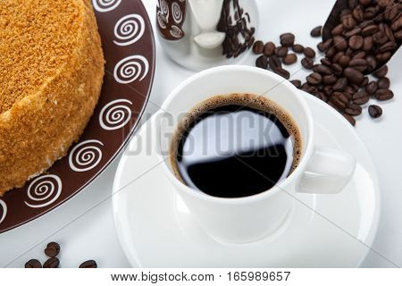 whole cream cake cup of coffee and beans