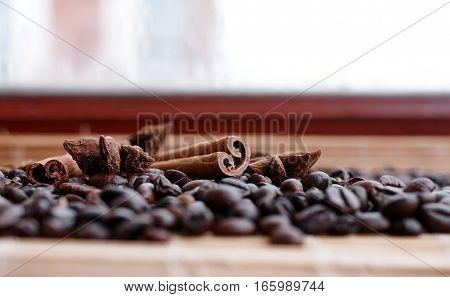 Closeup Of Star Anise, Fresh Fragrant Vanilla Pods, Cinnamon Sticks And Coffee Grains, Seasoning  In