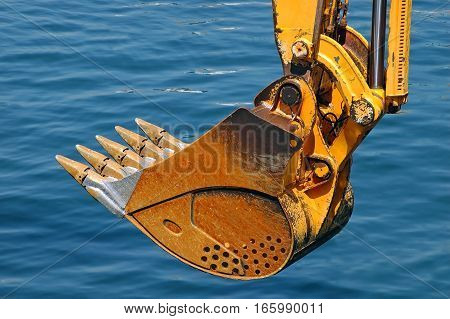 Rusty Bulldozer Scoop Over Water