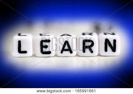 Learn word spelled with white beads on black background