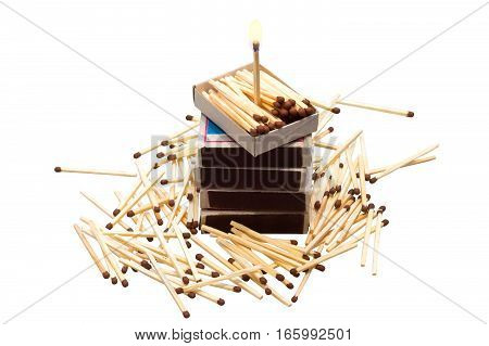 Matches in boxes and in bulk isolated on white background, and one standing burning match