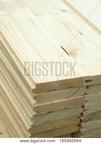 Rows of many planed planks outdoor close up vertical view