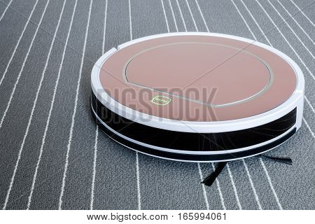 robotic vacuum cleaner on grey carpet with white stripes smart cleaning technology